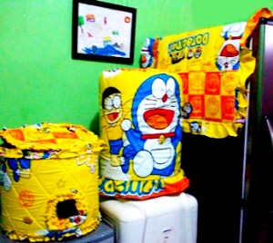 tutup Galon kulkas doraemon yellow  300x268 Tutup Galon, Kulkas dan Magic (GKM)